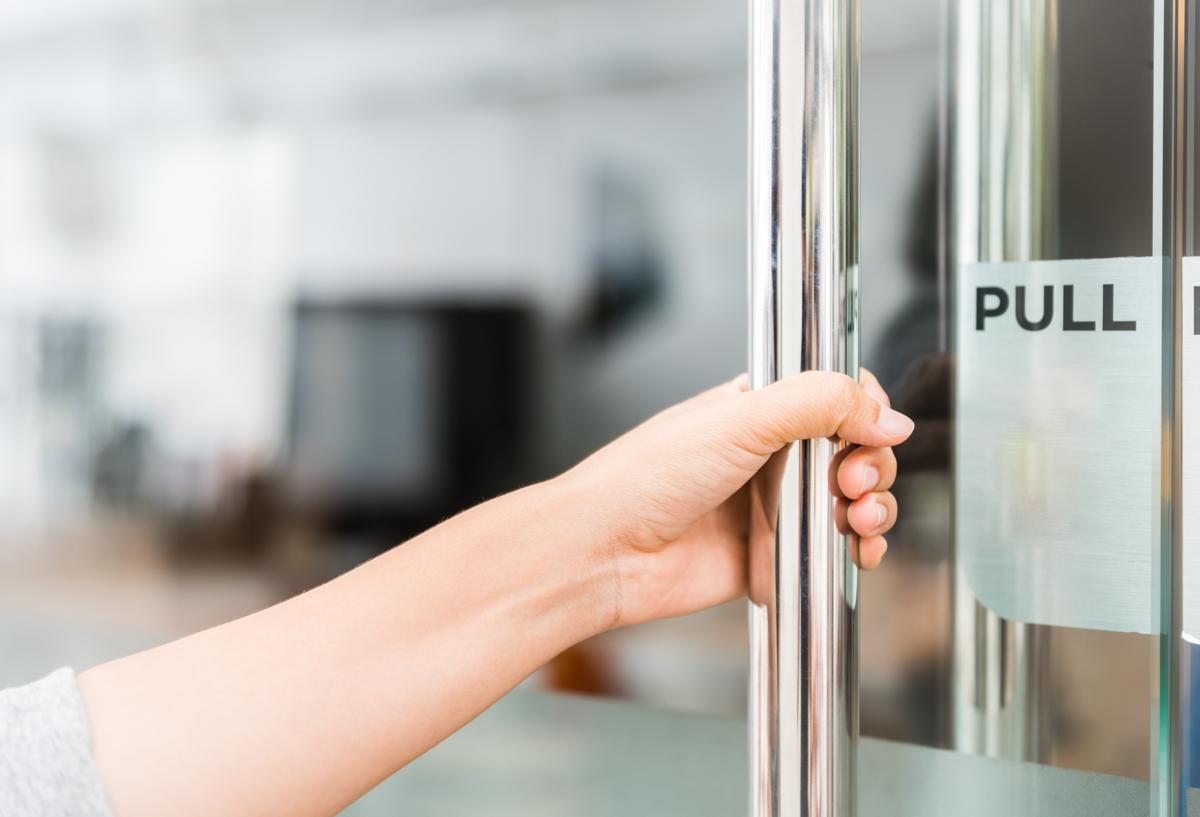 Closeup women hand open the door knob