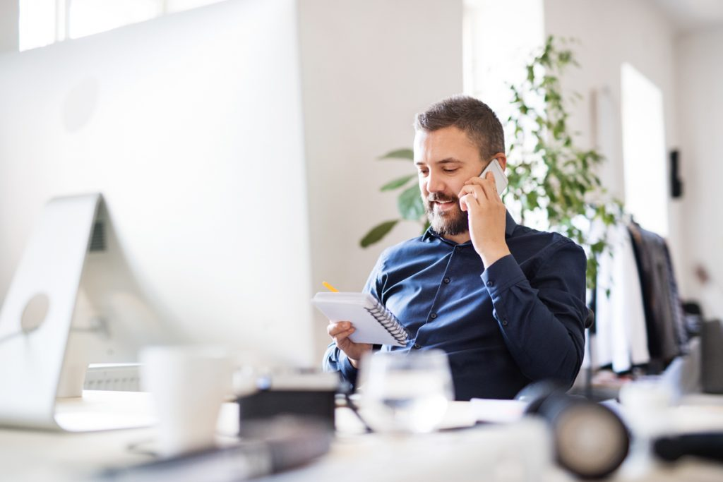 Businessman on the phone as his desk